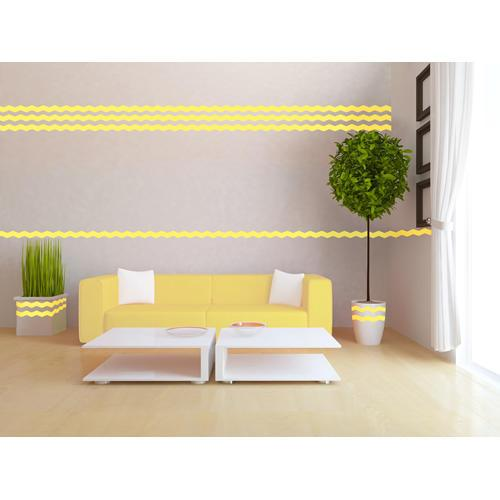 Paint lines creating yellow wavey art design on wall