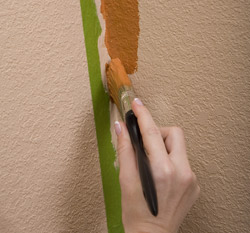 Apply a coat of paint along the edge of the tape