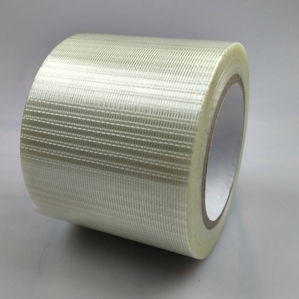 Roll of 100mm Glass Filament Crossweave Strapping Tape on its back