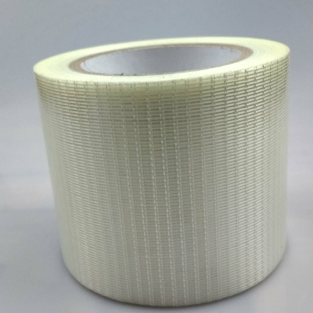 Roll of 100mm Glass Filament Crossweave Strapping Tape on its side